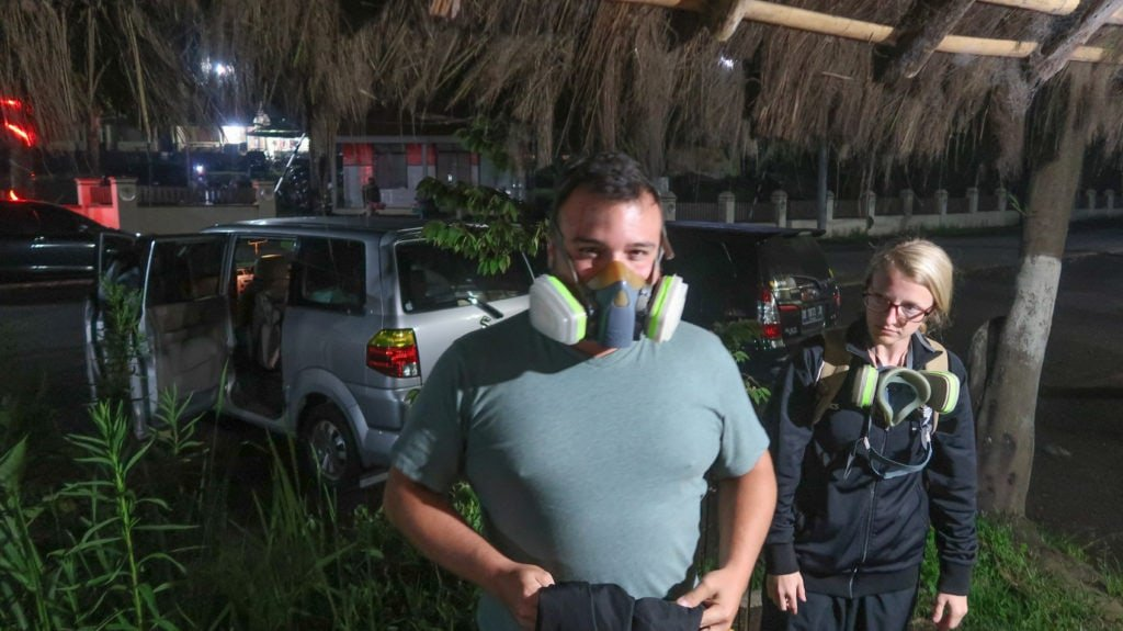 Preparing for our hike up Mt Ijen with gas masks and gloves