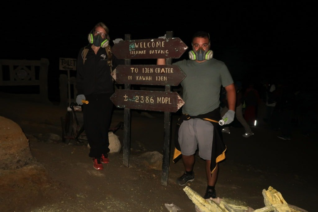 Standing near the entrance to the Mount Ijen hike