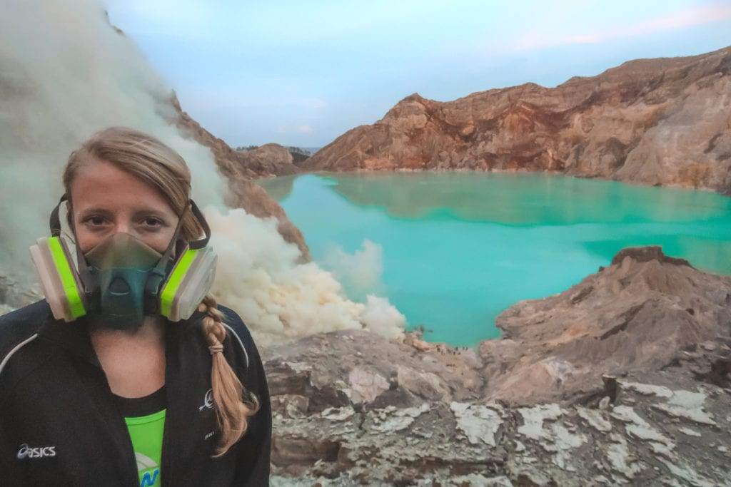 Laura standing next to the acidic lake during the Mt Ijen hike.