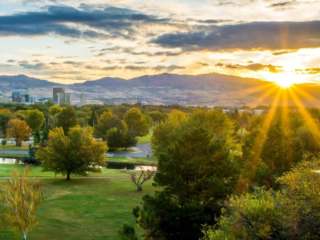 Sunrise on downtown Boise, Idaho during the summer. The mountains in the background in a slight fog.