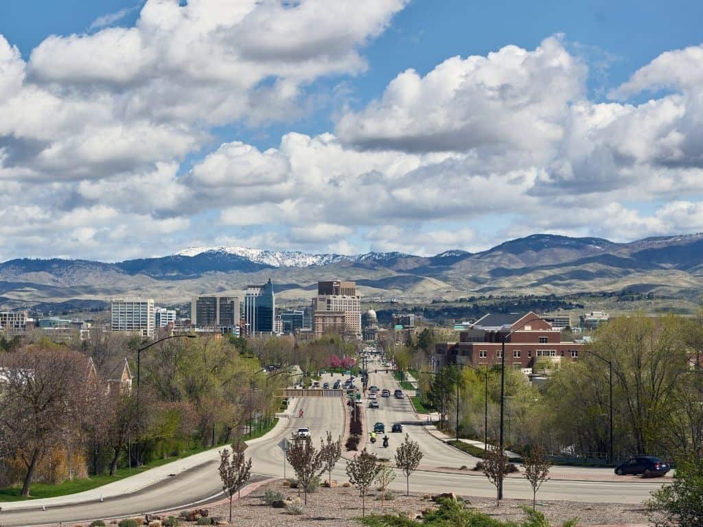 A beautiful picture of downtown Boise, Idaho with the foothills and mountains in the background.