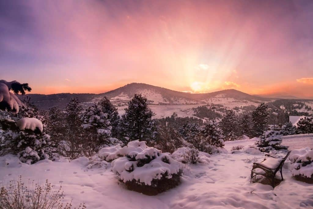 Pink and purple sunrise over snowy Colorado mountains