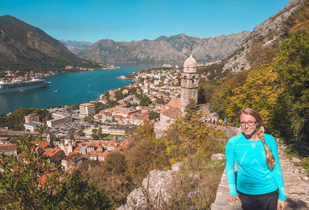 Laura standing on the Fortress Walls in Kotor, Montenegro. The city of Kotor is behind.