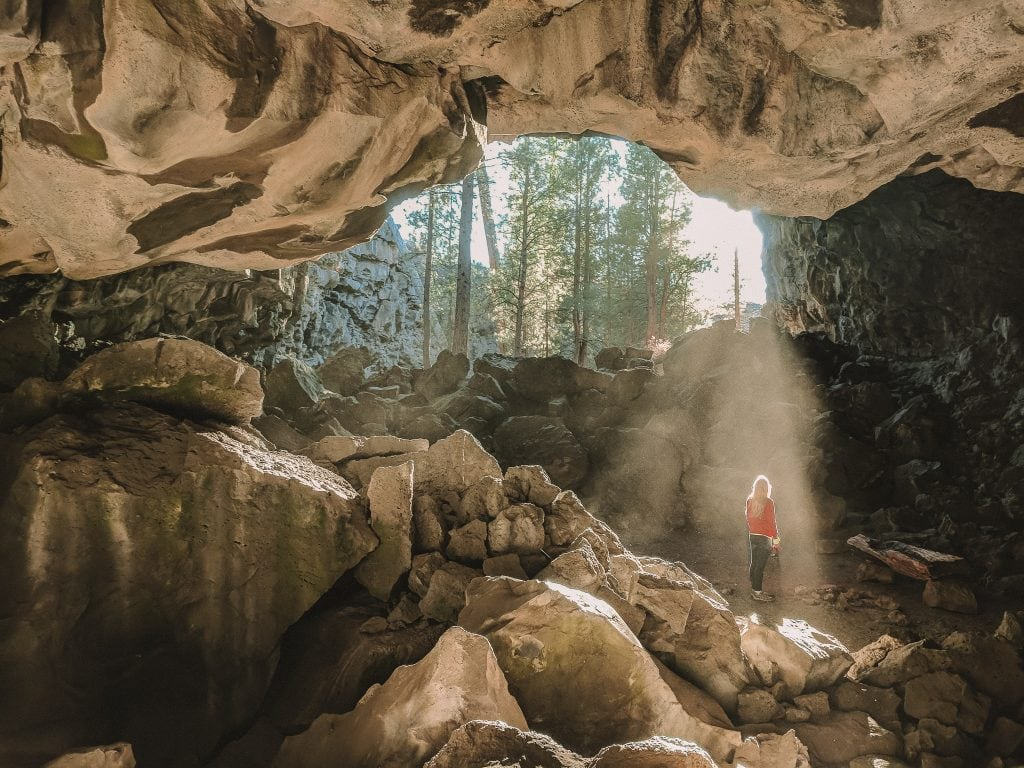 Hidden Forest Cave Near Bend, Oregon On A Sunny Summer Day