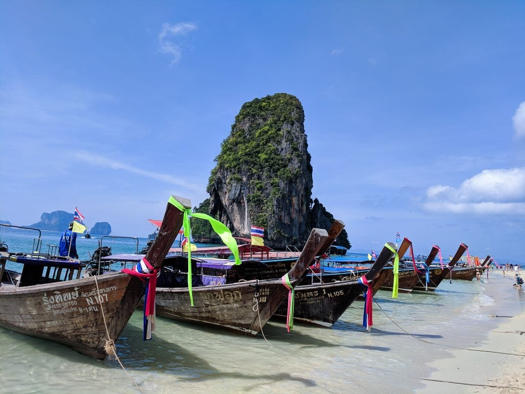Railay Beach With Long Tail Boats In Krabi, Thailand Is One of The Best Places To Stay.