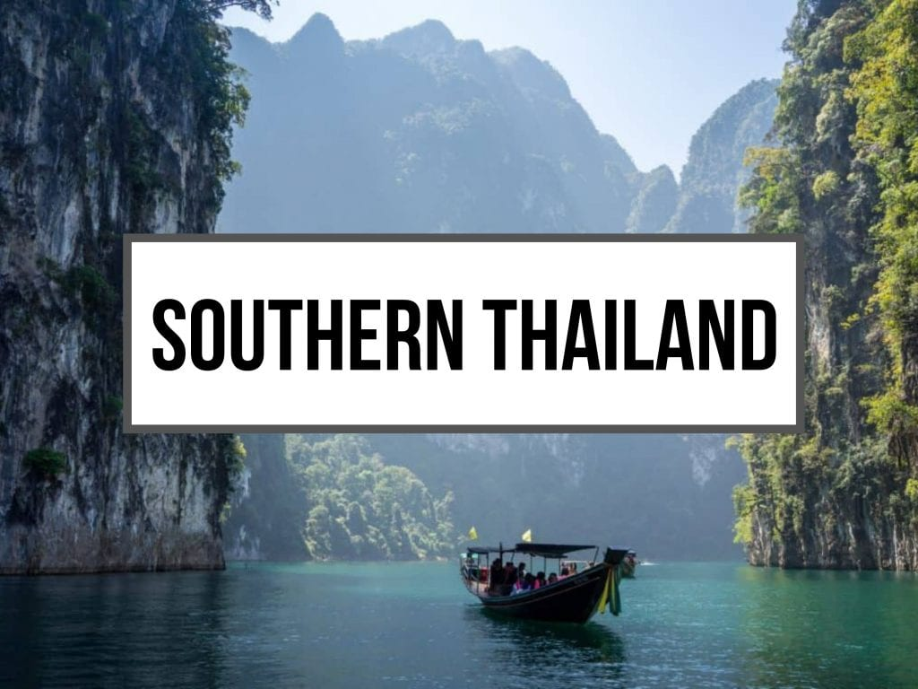 Limestone Cliffs in Southern Thailand With Long Tail Boat