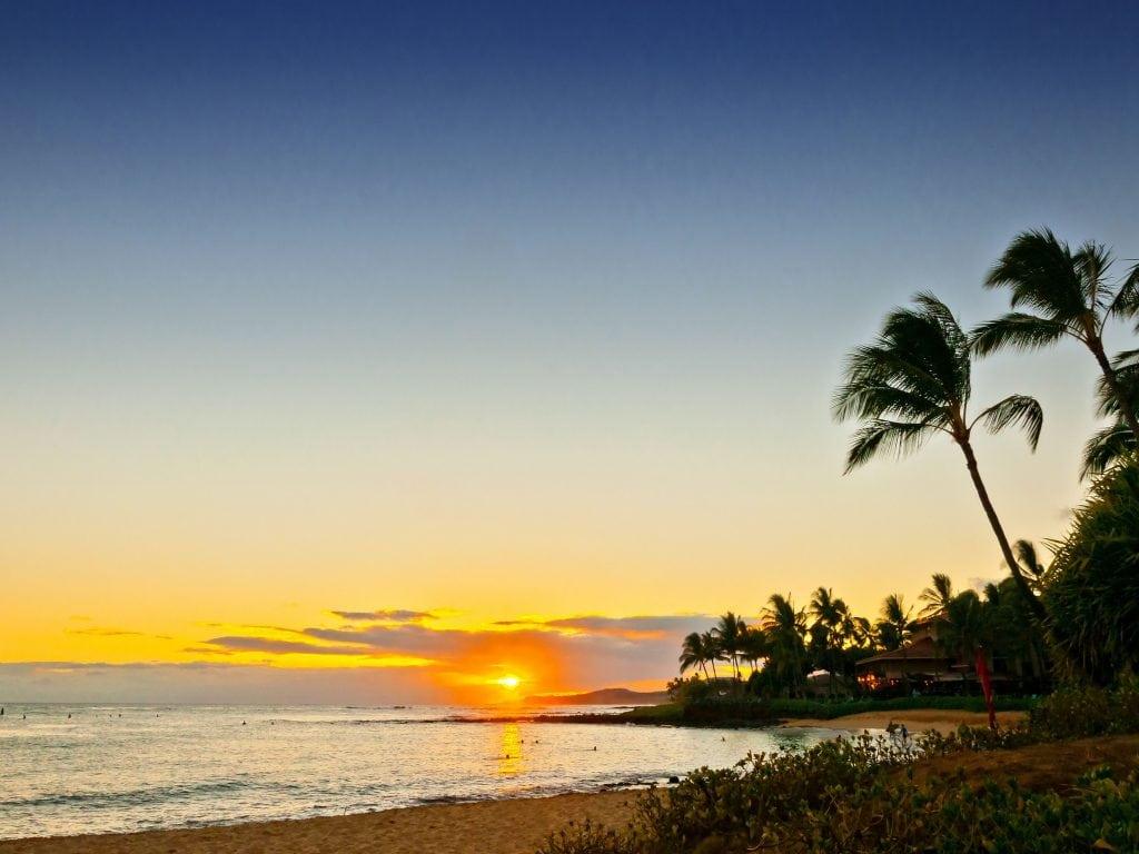 Sun Setting Over Poipu, Kauai. Enjoying A Beach Sunset Is One of the Most Relaxing Things To Do In Kauai.