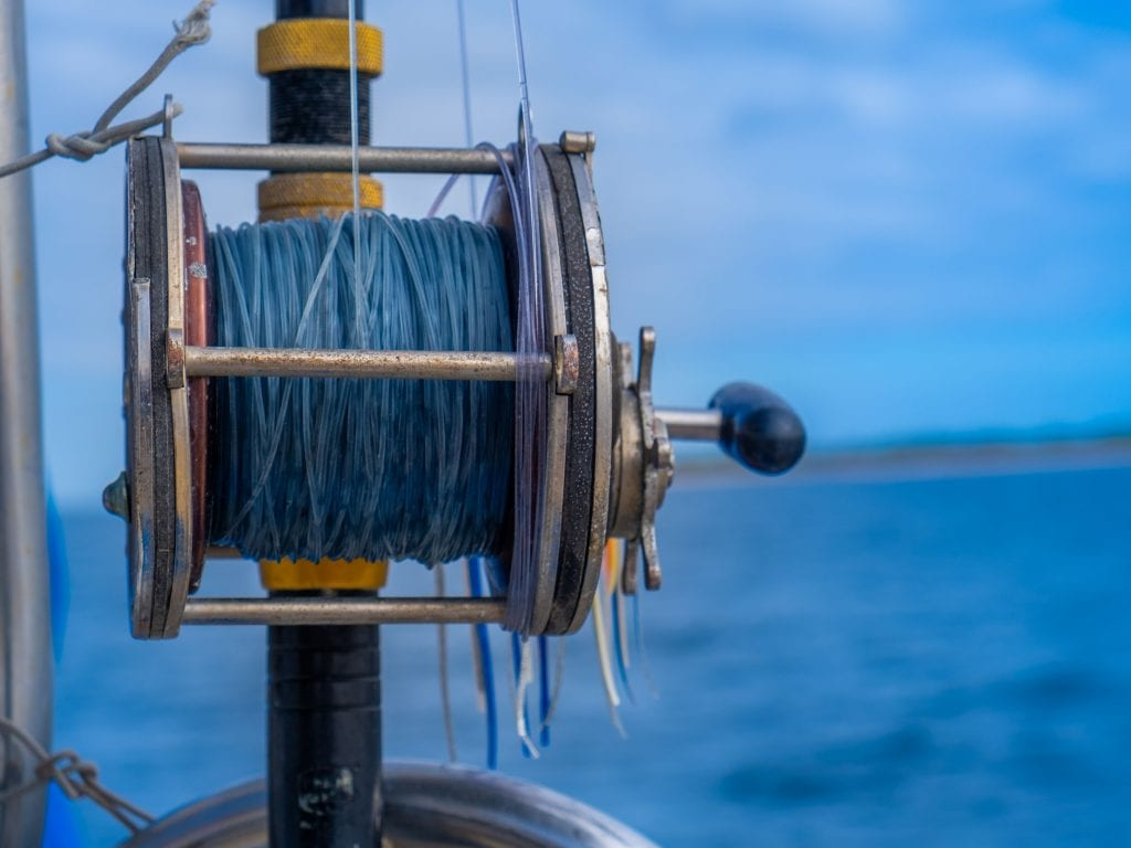 Deep Sea Fishing Rod and Ocean in the Background.