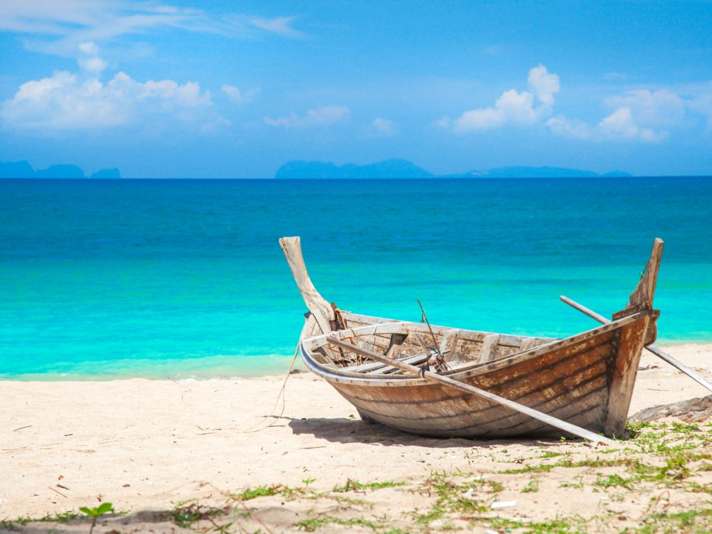 Ko Lanta Beach With Boat. One of the Best Places To Stay In Krabi.