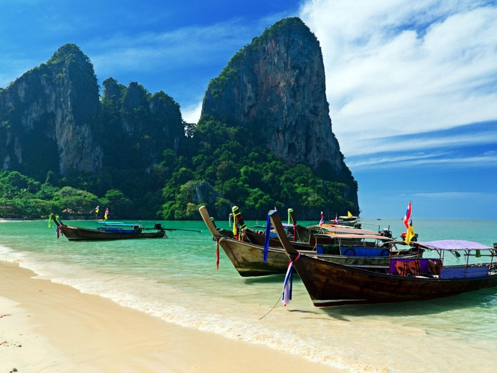 Railay Beach In Krabi, Thailand With Long-Tail Boats