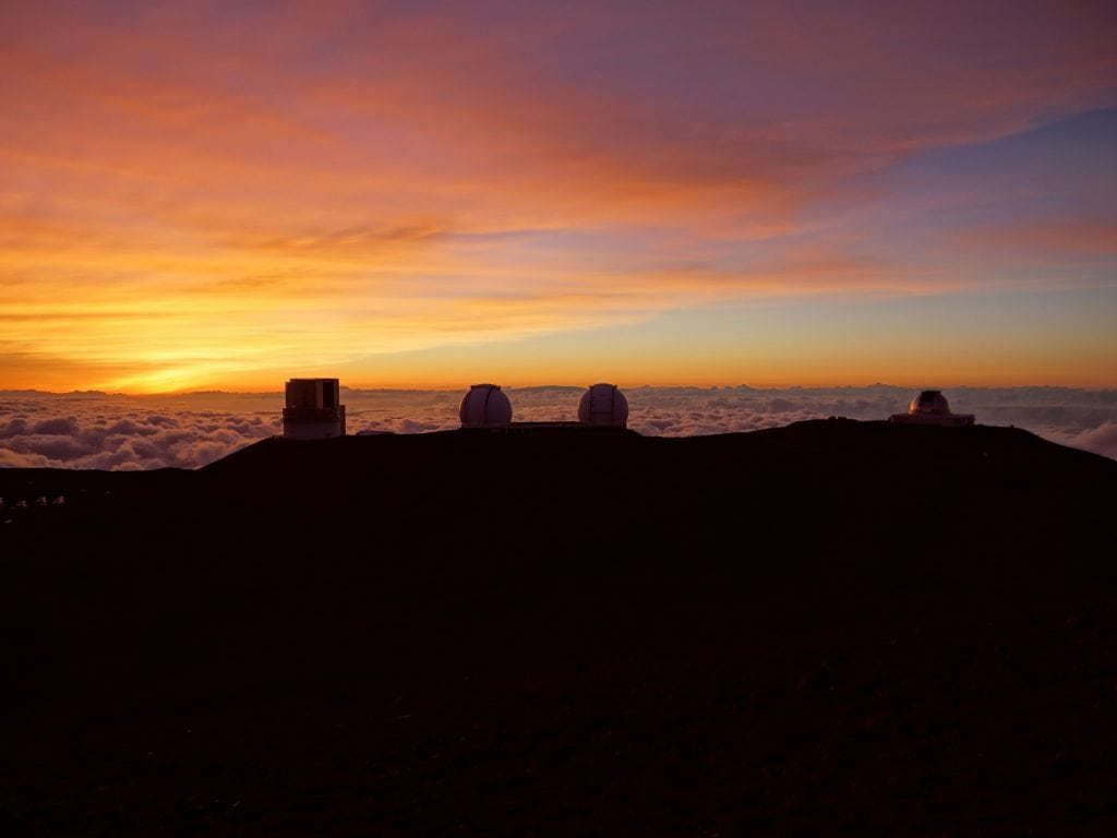 Sunrise Over The Big Island With The Telescopes Visable.