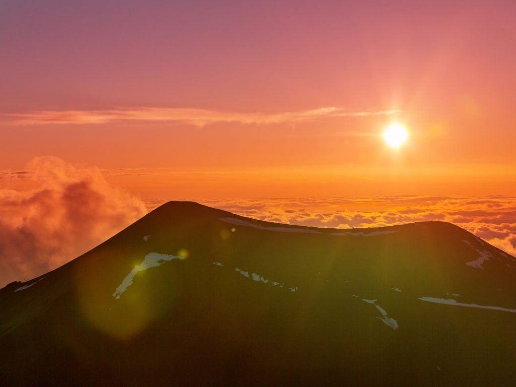 A Pink And Orange Sky Over Mauna Kea.