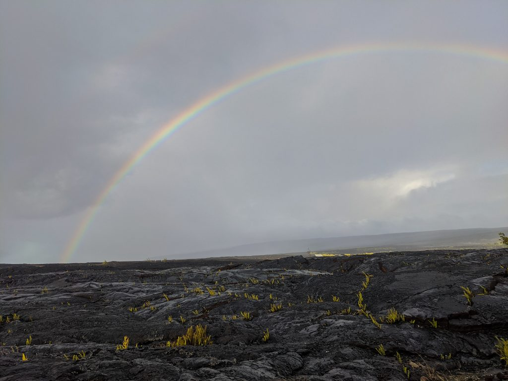 Lava Field With Rainbow After A Heavy Rainstorm.
