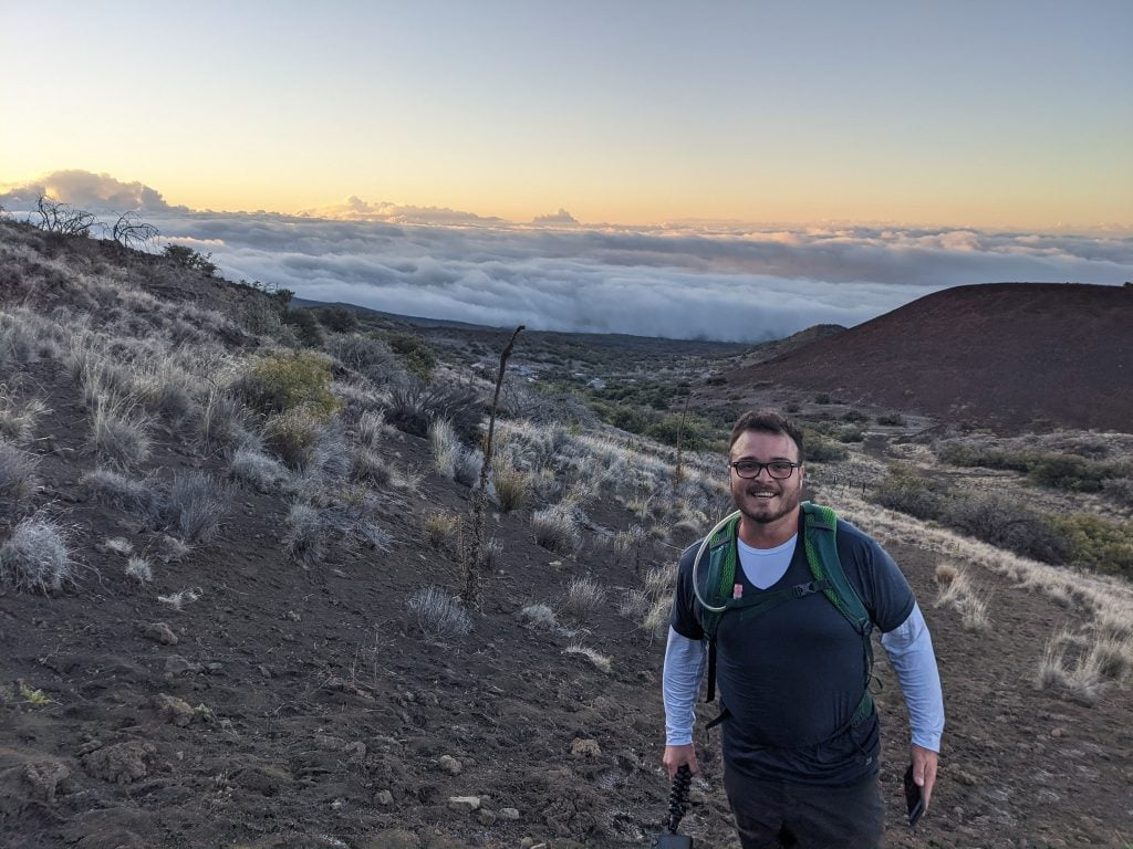 Mike at the Trailhead of Mauna Kea at Sunrise. This is One of The Best Things To Do In Hilo, Hawaii.