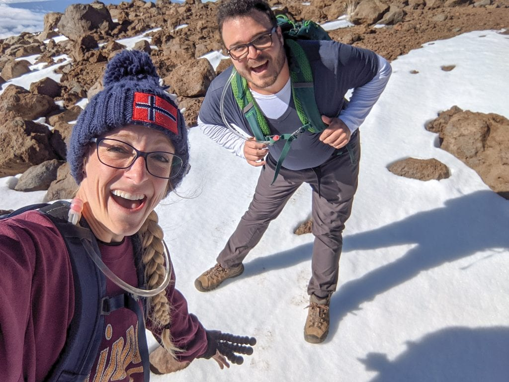 Mike & Laura Standing On Snow With Excitement on the Way To The Top of Mauna Kea.