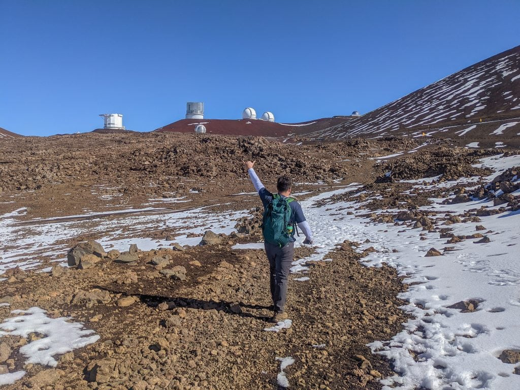 Mike during the Mauna Kea Hike with Telescopes in the Background.