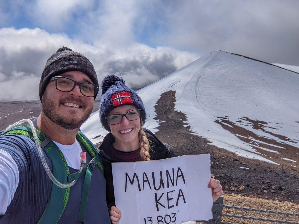 Standing Near The Summit of Mauna Kea After A Long Hike. Mauna Kea Is Snow-Covered.