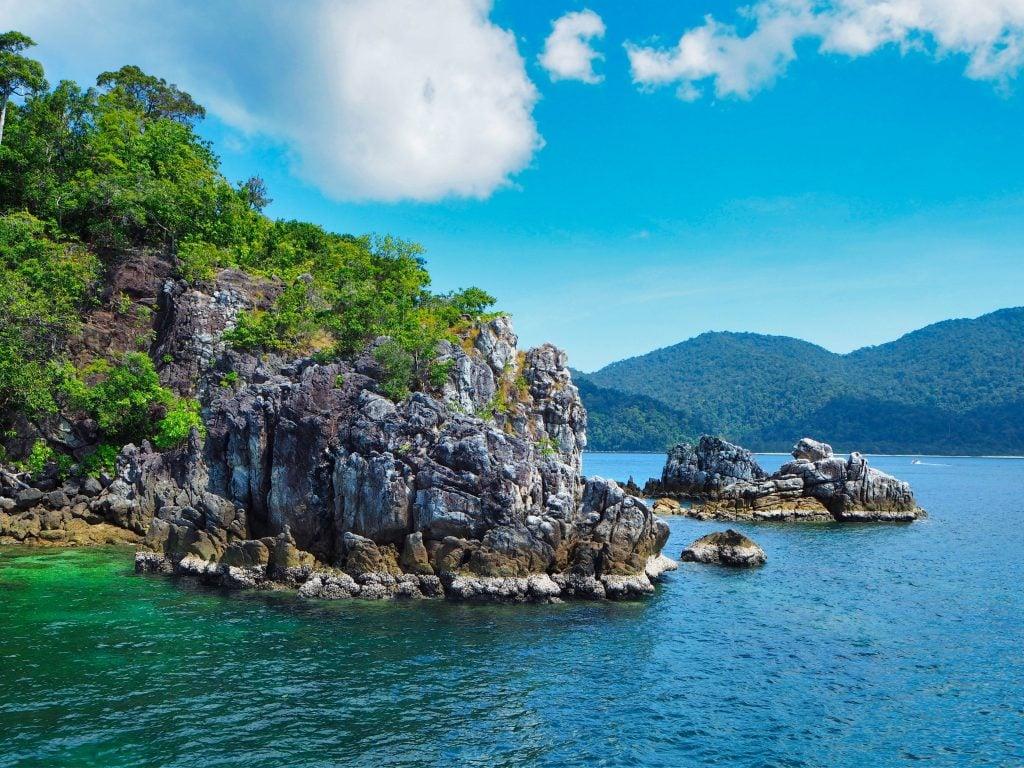 Koh Adang Rocky Coastline With Blue Skies.