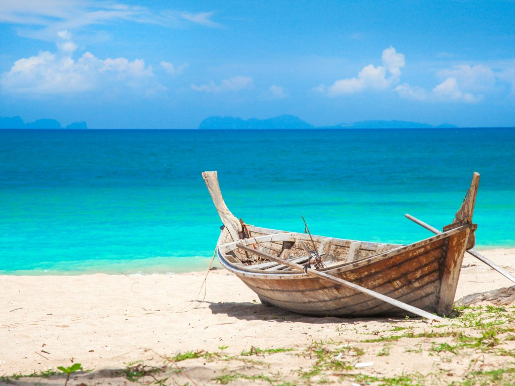 Wooden Boat on the Beach in Koh Lanta, Thailand, A Great Destination For Island Hopping.
