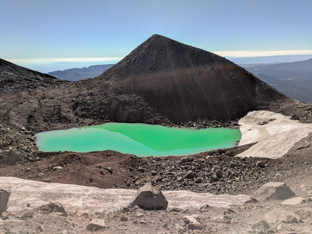 A View From The South Sister Trekking Trail With An Aquamarine Lake.