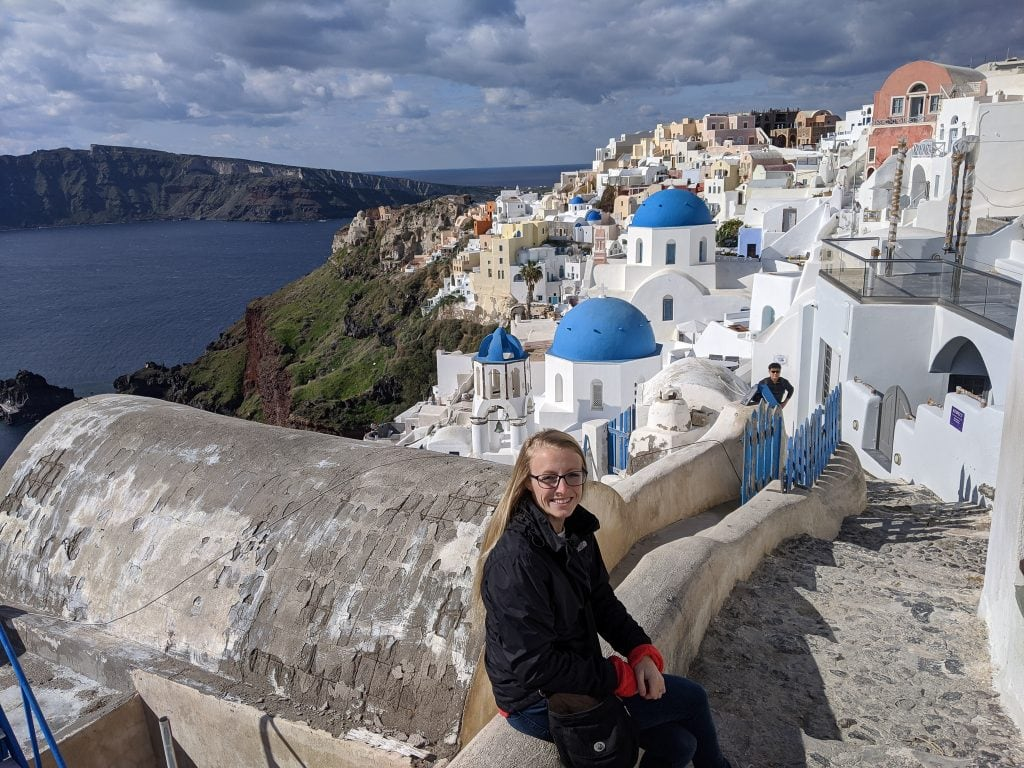 Laura Sitting In Santorini, Greece. A Great Island Hopping Trip From Milos.