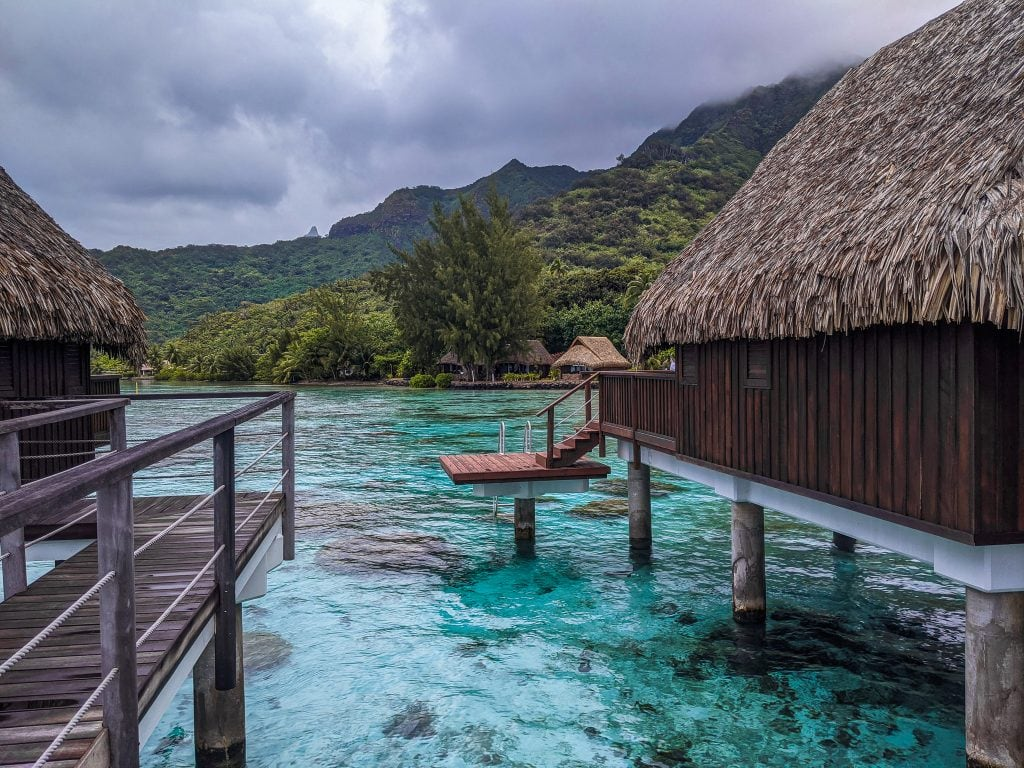 Rain Clouds Over Overwater Bungalows On Moorea, French Polynesia.