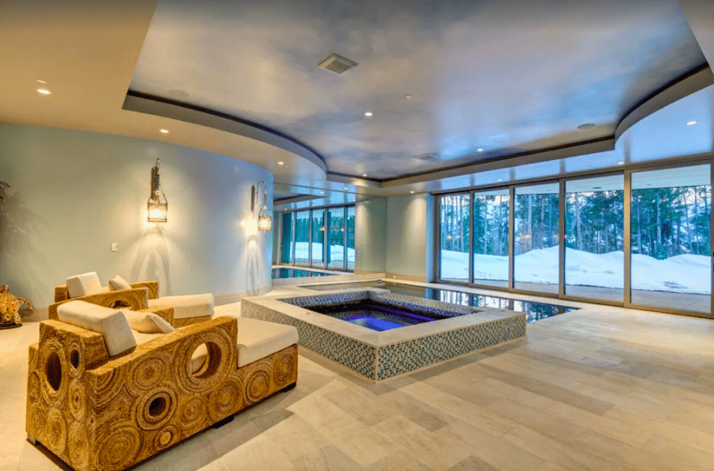 A Beautiful Indoor Pool Area in An Airbnb