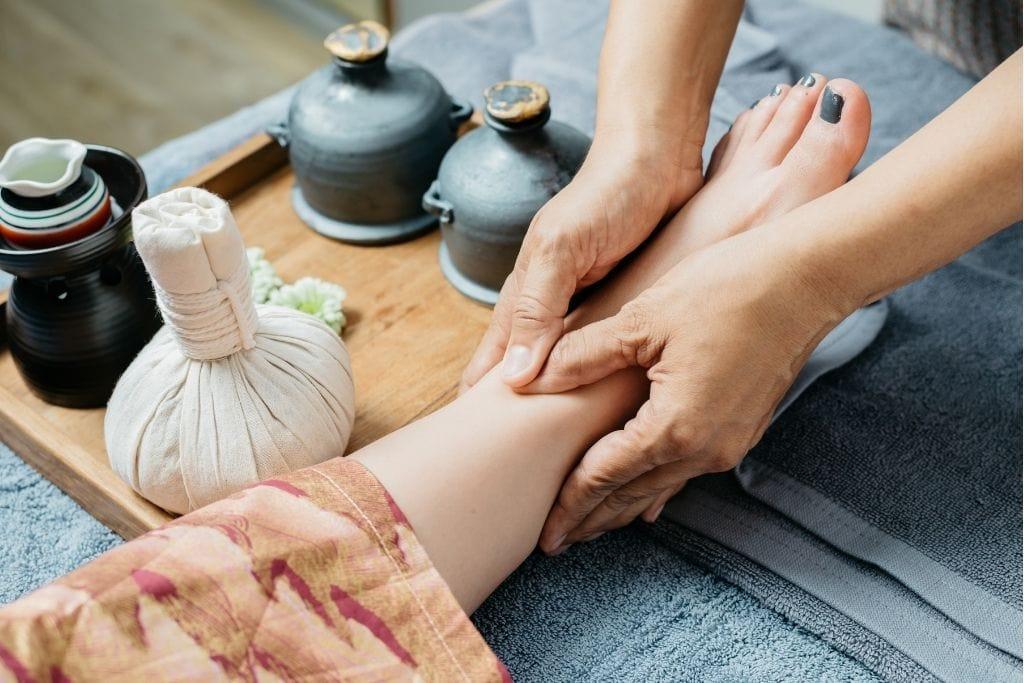 Foot massage in Thailand.