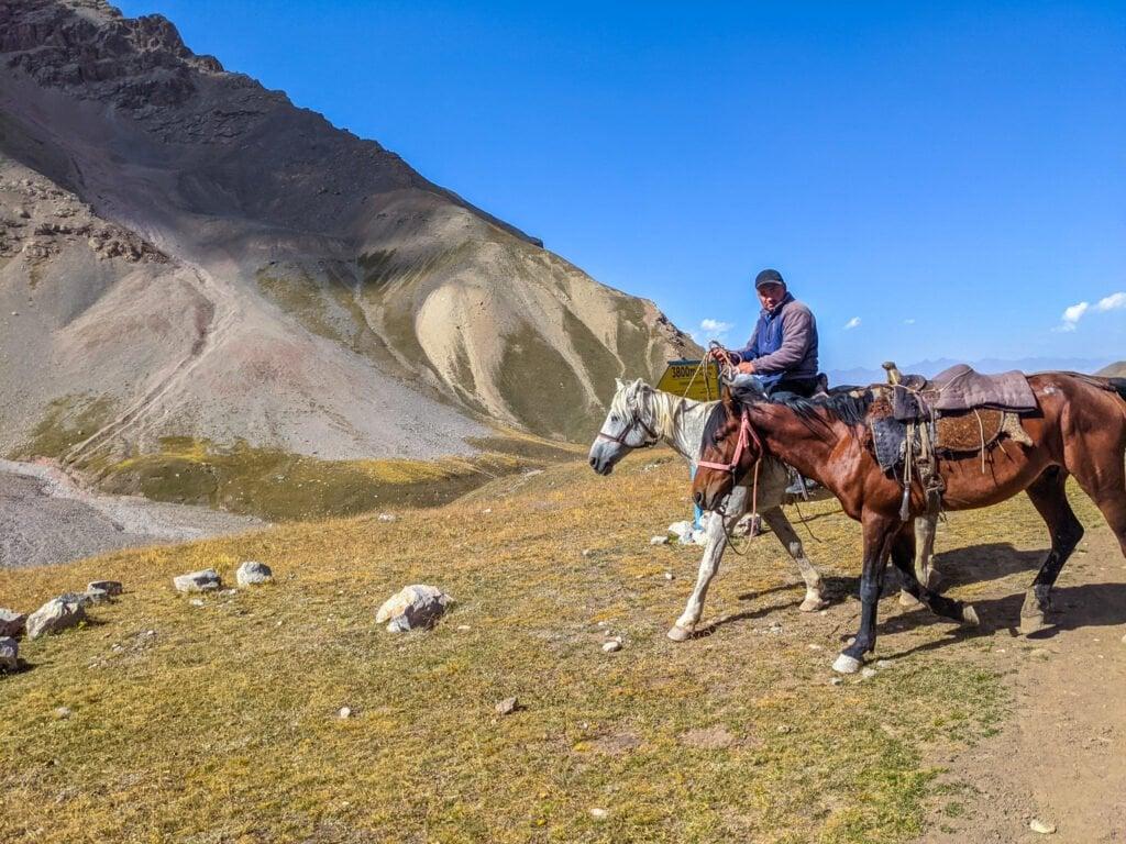 A Man Riding On A Horse In Kyrgyzstan.