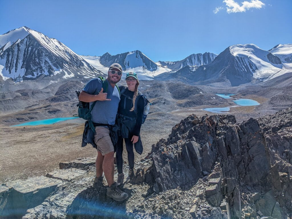 Standing On The Top of Sary Mogol Pass with Beshkol Lake In The Background.