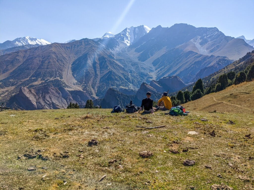 Sitting On The Edge of a Hill Looking Out To The Alay Mountains In Kyrgyzstan.