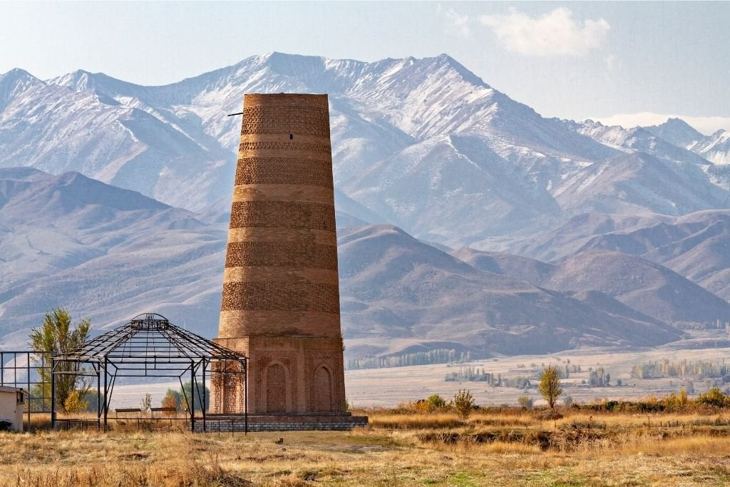 Burana Tower With The Tien Shan Mountains In The Background.