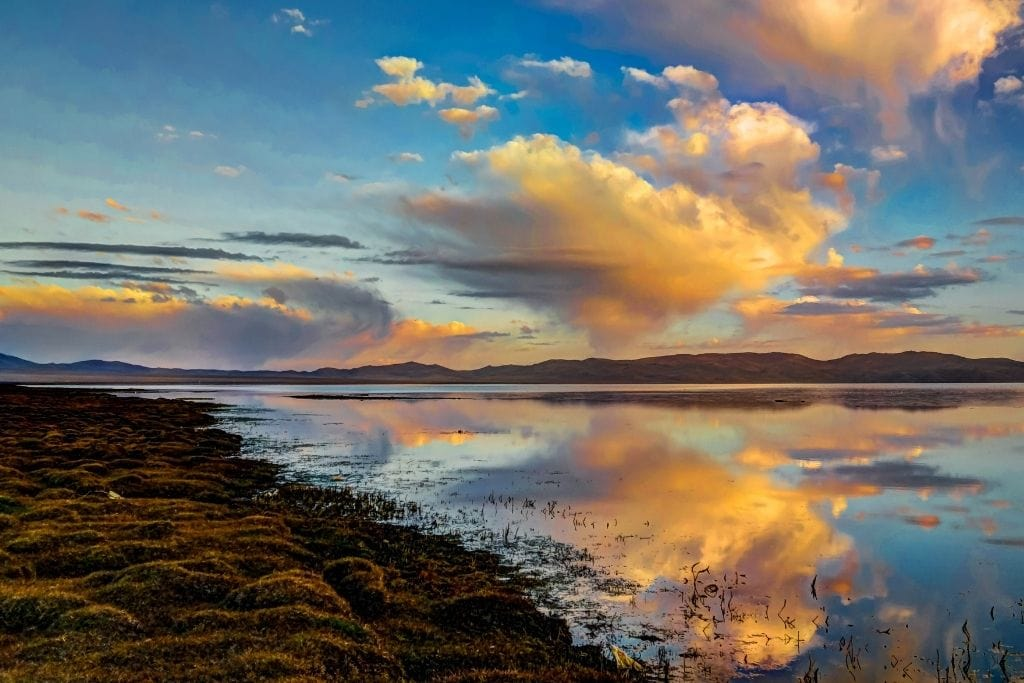 Song Kul Lake At Sunrise Is A Must Visit For Your 2 Week Kyrgyzstan Itinerary.