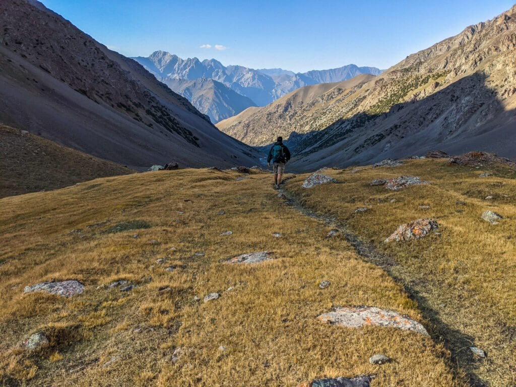 Walking Down Into The Valley In Kyrgyzstan.