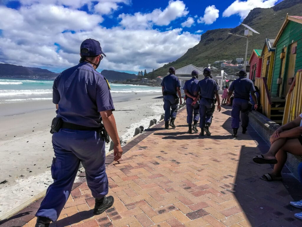 Police Walking Down The Beach In Cape Town.